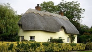 a thatched cottage in the UK is the photo alongside an article about gifted deposits