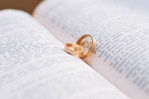 Wedding rings on a religious book