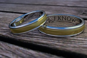 two rings on a wooden table