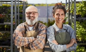 Image of family run garden centre. Image shows father and daughter managing together. Concept of Family Business Dispute Resolution.